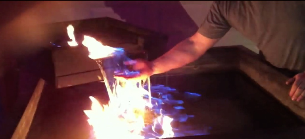pyro boy: promethean fountain: hand on fire